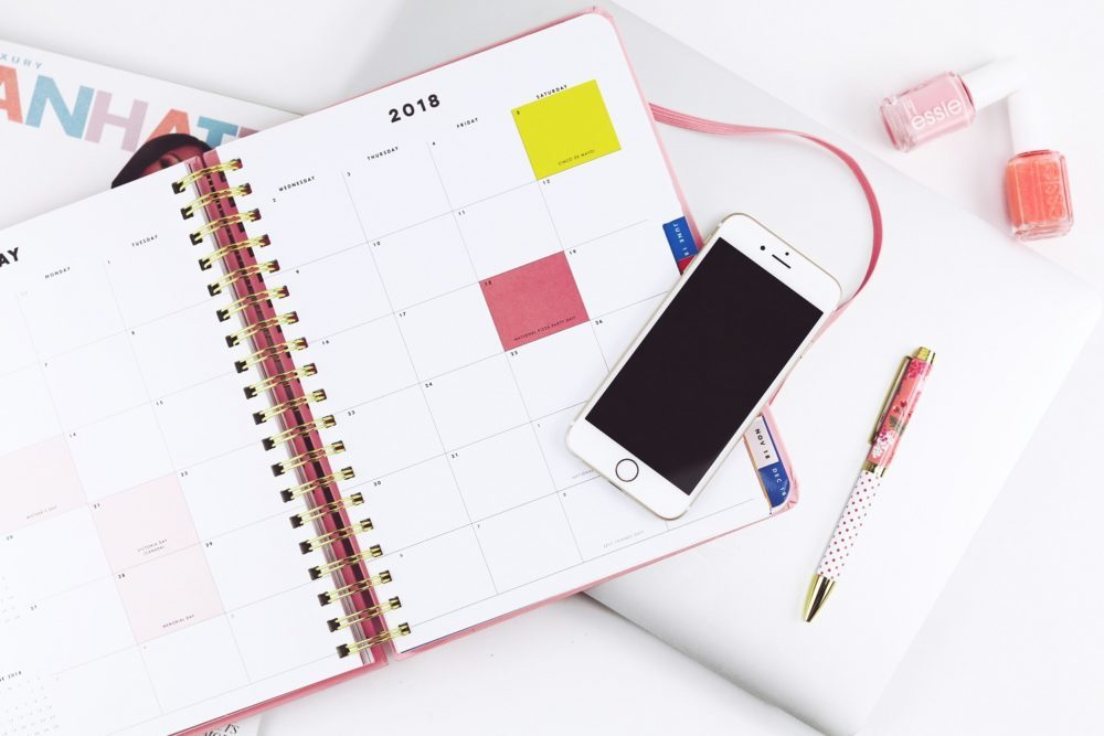 How do you want to feel in the new year? iPhone, planner, and pen